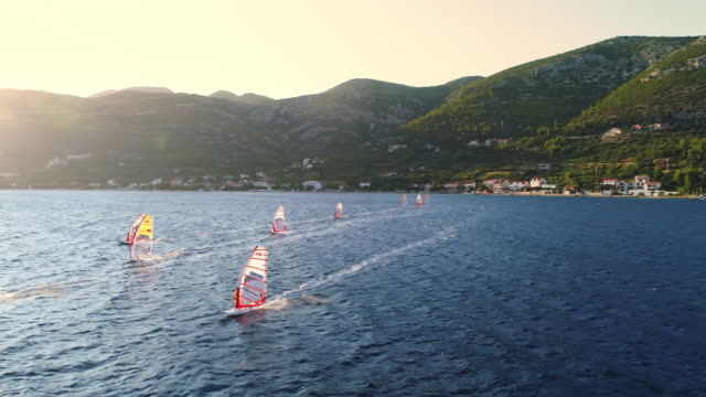 ws windsurfers racing along sunny blue ocean,peljesac,croatia - extreme sports stock videos & royalty-free footage