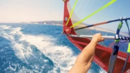POV Windsurfing along the coastline