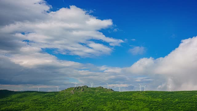 wind-turbines landscape and heavy clouds time lapse video filmed by: costofto / barcroft studios / future publishing - cloudscape stock videos & royalty-free footage