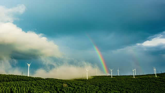wind-turbines landscape and heavy rain clouds and rainbow time lapse video in zhangjiakou, hebei province, china filmed by: costofto / barcroft... - landscape scenery点の映像素材/bロール