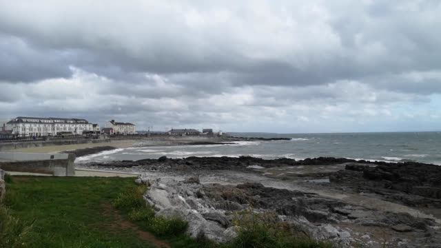 windy weather batters the coastline at porthcawl bridgend as yellow warnings for rain and wind came into force across nearly all of the uk the met... - coastline stock videos & royalty-free footage