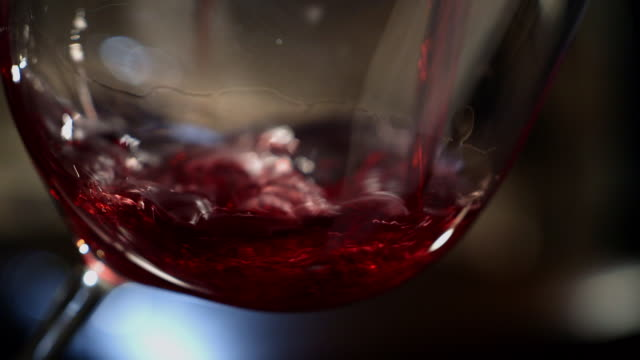 ecu wine being pored into glass - wine glass stock videos and b-roll footage