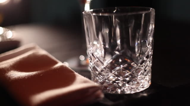 wine being poured and a candle being extinguished at a restaurant dining table - napkin stock videos & royalty-free footage