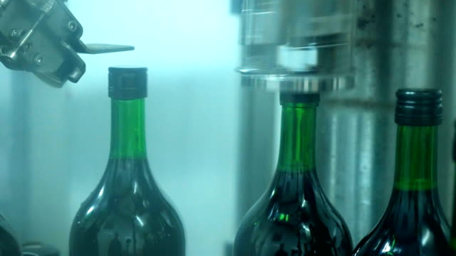 wine bottle filling and bottle cap in production line in factory - bottle cap stock videos & royalty-free footage