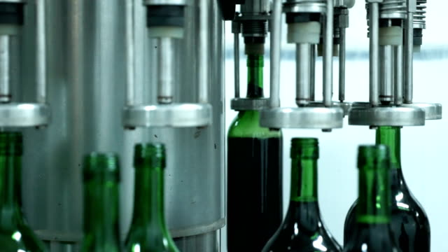 wine bottle filling production line in factory - wine cellar stock videos and b-roll footage