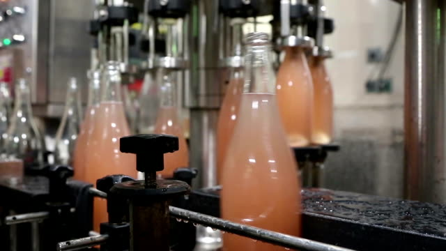wine bottles bottling automation machinery - bottling plant stock videos & royalty-free footage