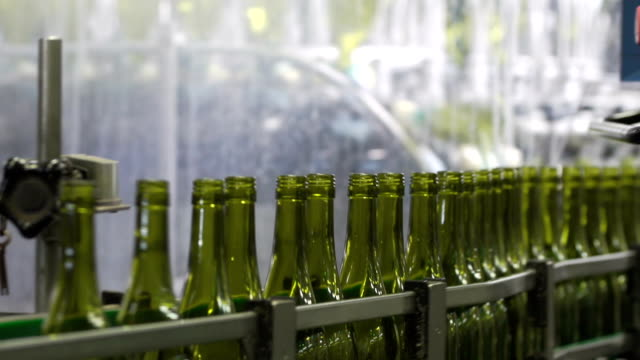 wine bottles in a wine bottling factory of south france - bottling plant stock videos & royalty-free footage