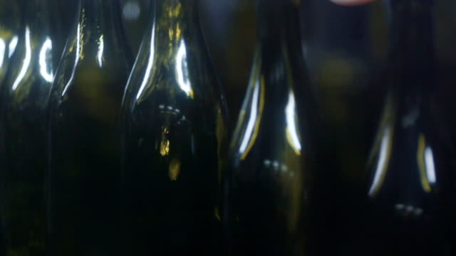 Wine bottles in a wine bottling factory of South France