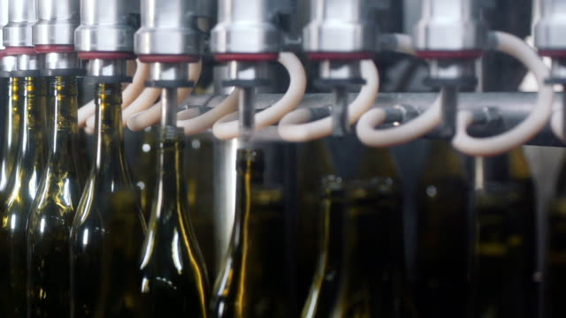 wine bottles in a wine bottling factory of south france - bottling plant stock videos and b-roll footage