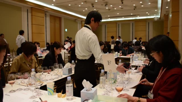 Wine bottles sit covered in cases for a blind tasting at the 4th Sakura Japan Women's Wine Awards 2017 the international wine competition judged by...