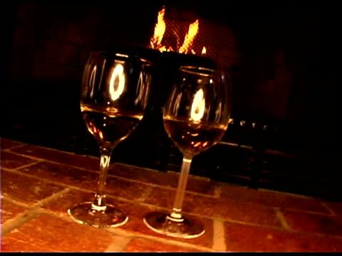vídeos de stock, filmes e b-roll de wine by fireplace - equipamento doméstico