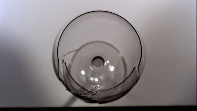 a wine glass breaks from sonic dissonance. - wine glass stock videos & royalty-free footage