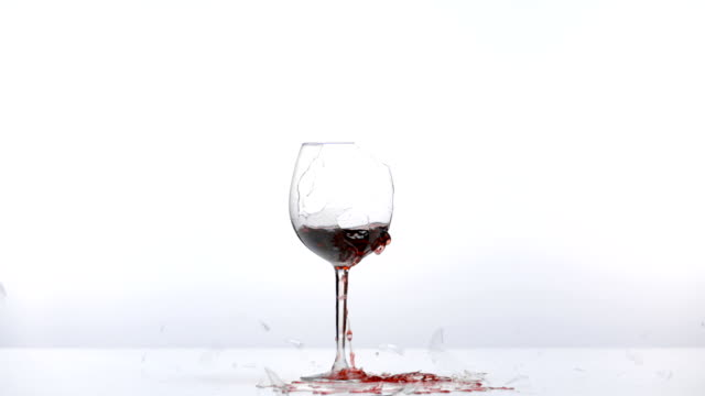 wine glass breaks - bicchiere da vino video stock e b–roll