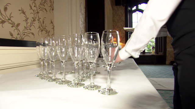 wine glasses being placed onto a table - silver service stock videos & royalty-free footage