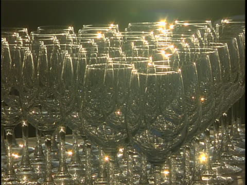 wine glasses catch a glint from the sun at golden hour - wine glass stock videos & royalty-free footage