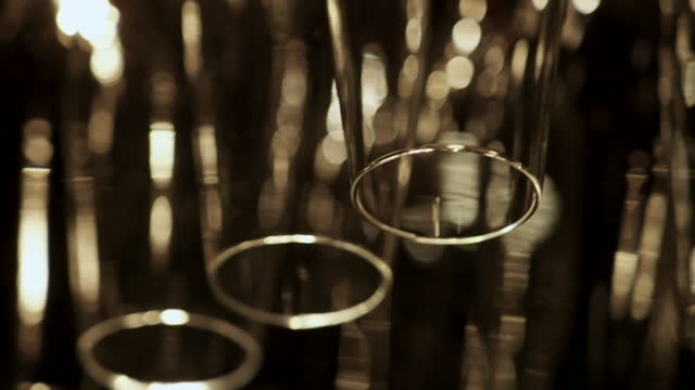 wine glasses hang upside down in bar - silver service stock videos & royalty-free footage