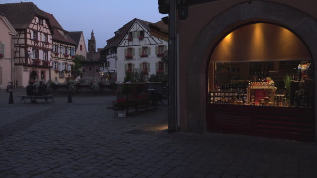 Wine shop at Chateau square in a picturesque village at night