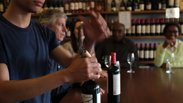 wine tasting session at cellar - bottle opener stock videos & royalty-free footage