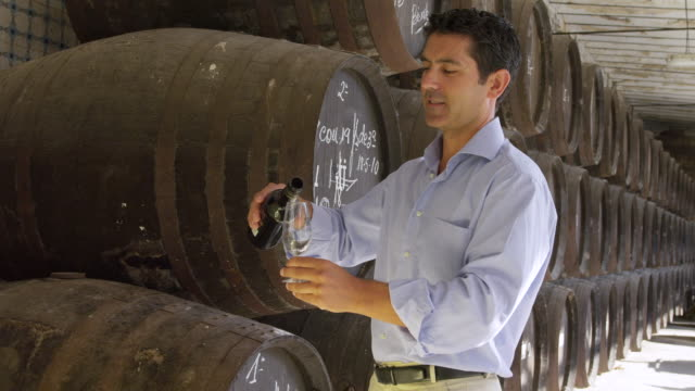 MS Winemaker smelling and checking wine /  Sanlucar de Barrameda, Andalusia, Spain