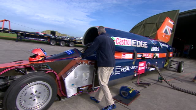 RAF Wing Commander Andy Green inspects the Bloodhound supersonic car he will pilot in a land speed record attempt