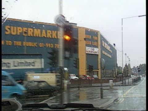 Stolen secrets court martial W London Acton LMS 'Car supermarket' TRACK FORWARD shot thru windcreen with windscreen wipers on MS Car supermarket...
