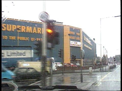 wing commander david farquhar: stolen secrets court martial; tx 24.6.91 rain england london acton lms 'car supermarket' track forward - shot thru... - sunny video stock e b–roll