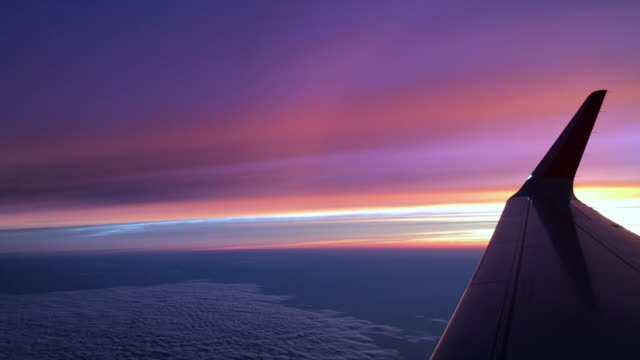 wing of an airplane under the beautiful twilight sky - aircraft wing stock videos & royalty-free footage