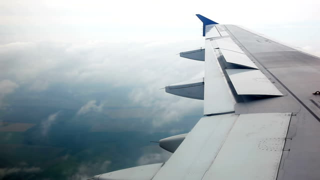 wing of plane flying in the clouds - aircraft wing stock videos & royalty-free footage