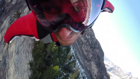 pov of wing suit flier soaring above valley and ridge crest - extreme sports stock videos & royalty-free footage
