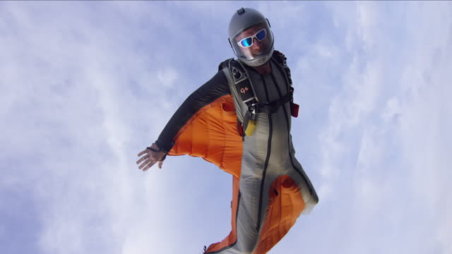 wing suit pilot closup - base jumper stock videos & royalty-free footage