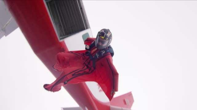 wing suit pilot exits airplane - base jumper stock videos & royalty-free footage