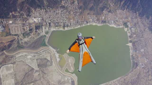 Wing Suit Pilot Over Lake