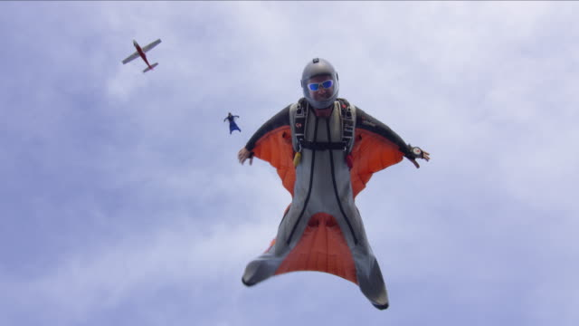 Wing Suit Pilots Exit Airplane