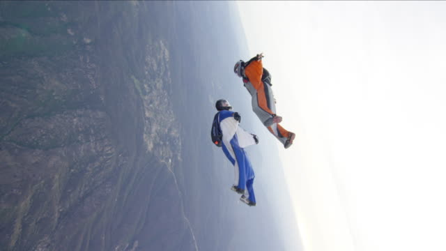 Wing Suit Pilots Flying In Close Formation