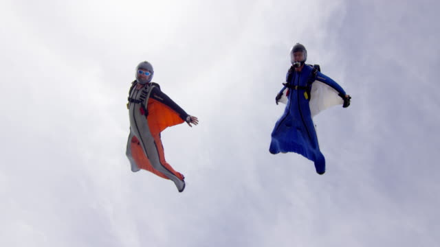 Wing Suit Pilots Flying Over Camera