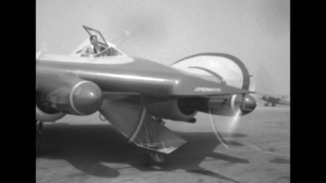 wingless aircraft on runway moving to camera / airplane designer bill horton and friend inside cockpit they close down cockpit doors over them pan to... - airplane tail stock videos and b-roll footage