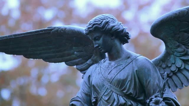 wings spread from the statue of an angel in new york city's central park. - ängel bildbanksvideor och videomaterial från bakom kulisserna