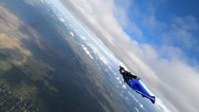 wingsuit cruising - cumulus stock videos & royalty-free footage