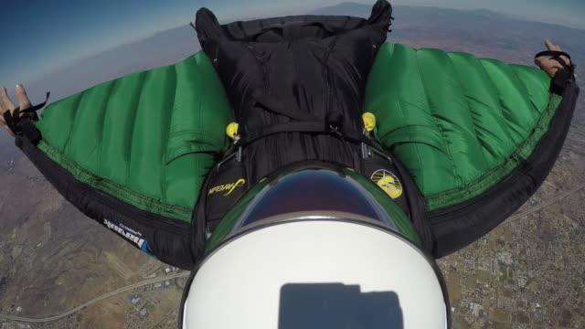 wingsuit flight - helmet pov with gopro - fallschirm stock-videos und b-roll-filmmaterial