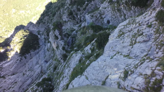 Wingsuit flyer jumps off cliff