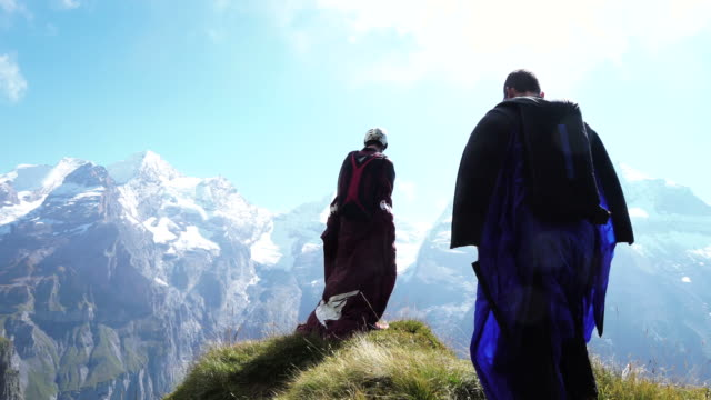 wingsuit jumpers prepare to jump from mountain ridge - helmet stock videos & royalty-free footage