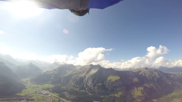 wingsuit jumping and flying from high mountain cliff - wearable kamera stock-videos und b-roll-filmmaterial