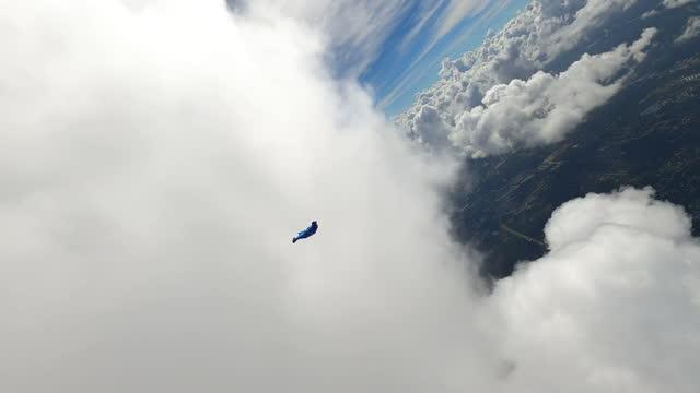 wingsuit passing cloud - cumulus stock videos & royalty-free footage