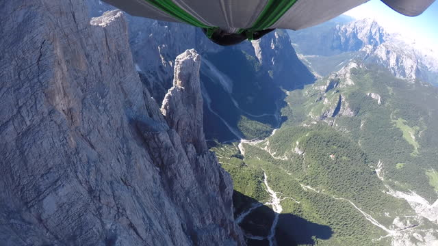 pov of wingsuit pilot flying close to cliff - 10 seconds or greater stock videos & royalty-free footage