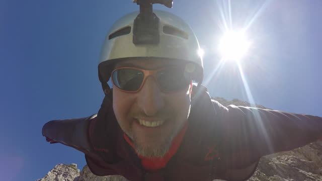 pov of wingsuit pilot jumping off cliff - cliff stock videos & royalty-free footage