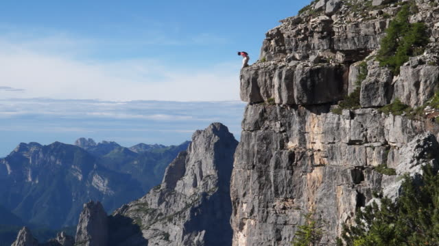 Wingsuit pilot jumps off cliff