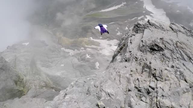 Wingsuit pilot jumps off cliff