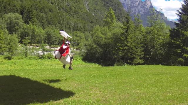 wingsuit pilot landing - landing touching down stock videos & royalty-free footage