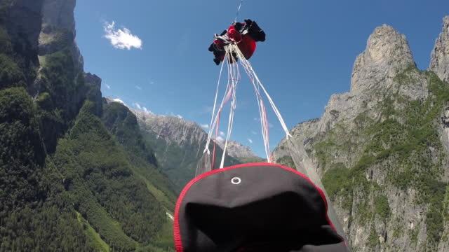 Wingsuit pilot opens parachute