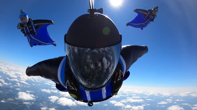 wingsuit pov reflective visor - air vehicle stock-videos und b-roll-filmmaterial